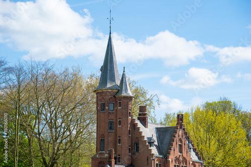Fotobehang Brugge Minnewater castle at the Lake of Love in Bruges, Belgium