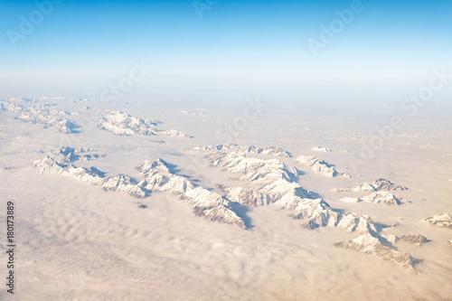 Papiers peints Blanc aerial view of snowy alps range, during winter season
