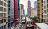 Elevated Train Tracks above the streets and between buildings at The Loop - Chicago, Illinois, USA - 180177429