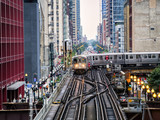 Elevated Train Tracks above the streets and between buildings at The Loop August 3rd, 2017 - Chicago, Illinois, USA - 180177626