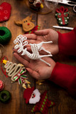 Hands of woman decorating Christmas gifts and decorations - 180179639
