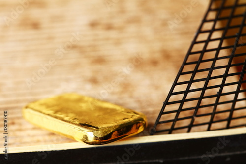 57c52401a261 Gold bar put on the floor of miniature ship model scene.