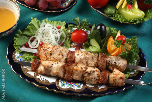Kebab chicken fillet with sheep fat pickled in grape vinegar.Cumin,coriander seeds,salt,black pepper to taste.Served with onions, herbs,lemon.Uzbek cuisine. - 180198262