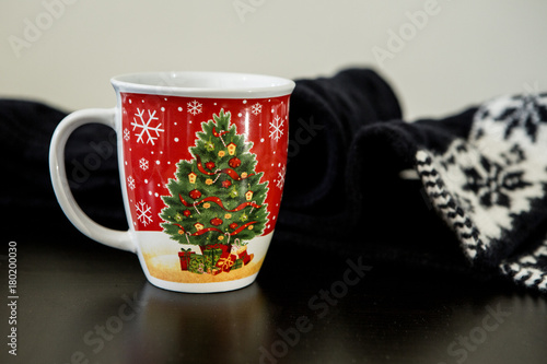 Foto op Canvas Chocolade Christmas Mug with Scarf on a Table