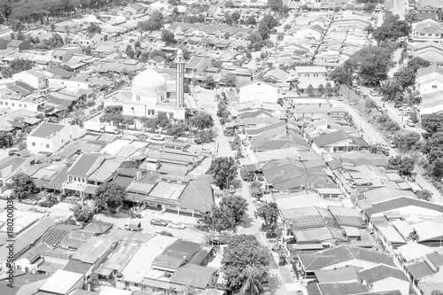 Fotobehang Kuala Lumpur Aerial view of mosque surrounded in suburb of Kuala Lumpur black and white