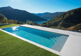 Modern swimming pool with lake and valley view - 180207271
