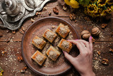 Food pastry background. Turkish traditional baklava dessert and tea concept - 180214612
