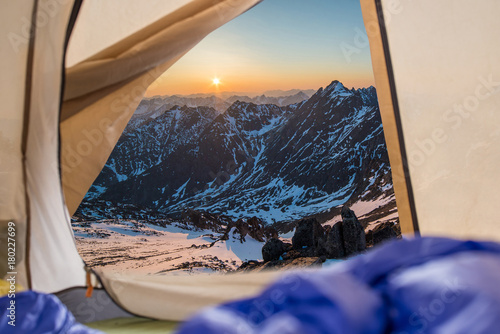 Foto op Plexiglas Beige View from tent on snow-capped mountains. Trips and expeditions in the wild. Concept of camping