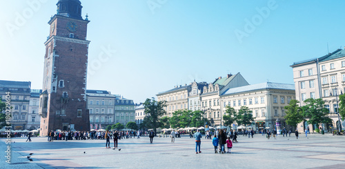 Foto op Canvas Krakau KRAKOW, POLAND - OCTOBER 1, 2017: Tourists in main city square. Krakow attracts 1 million visitors annually