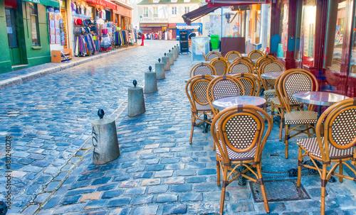 Fridge magnet PARIS, FRANCE - DECEMBER 2012: Tourists visit Montmartre art dis
