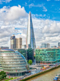 LONDON - SEPTEMBER 25, 2016: City skyline along river Thames. London attracts 30 million people annually