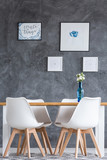 Dining room with concrete wall - 180244216