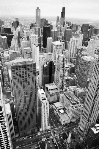 Fotobehang Chicago Urban city architecture background.Chicago skyline aerial view. An overhead view of the city of Chicago downtown taken from the John Hancock Center skyscraper. Vertical composition in black and white.