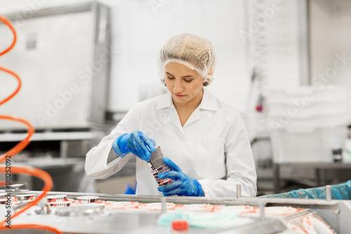 woman working at ice cream factory conveyor