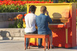 2 gay men play a piano outdoors in Montreal
