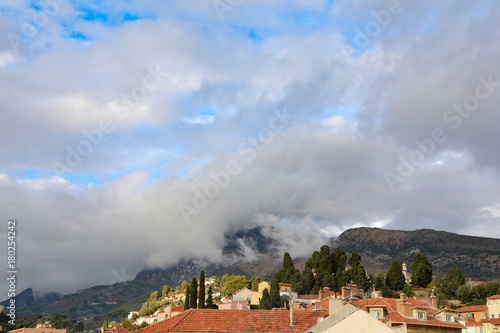 Fridge magnet Storm clouds on the Alps above Menton, France.