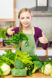Woman in kitchen having vegetables holding shopping basket - 180254495