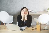 Bored woman at office desk - 180255278