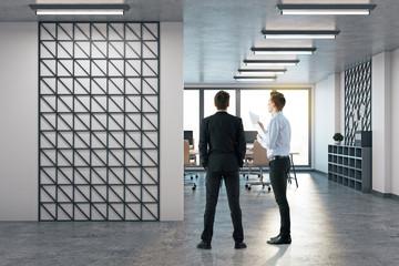 Businessmen in modern office