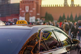 taxi to the center of the city on a busy street with many people and reflected in the glass evening lights of metropolis Moscow - 180266021