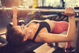 Fototapety Bodybuilder exercising with barbell in gym