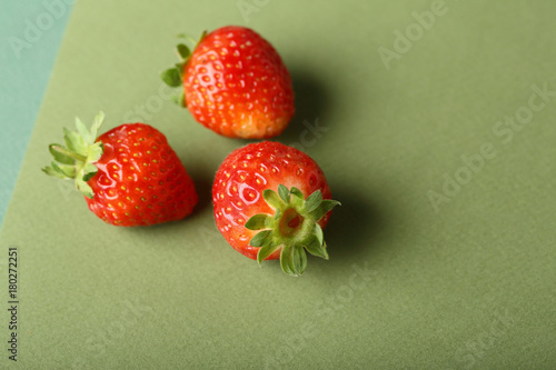 Fresh Strawberries on green background - 180272251