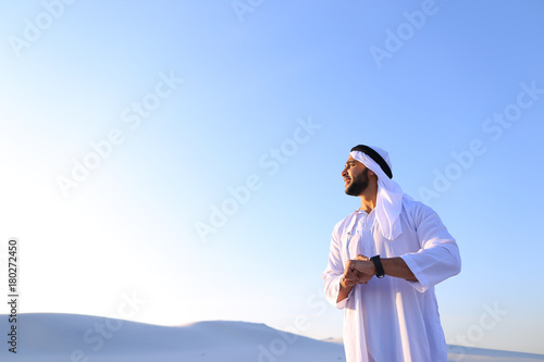 Foto op Canvas Abu Dhabi Portrait of handsome Arab businessman who experiencing new iWatc