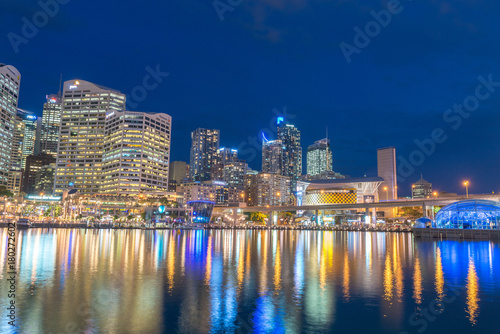 Fotobehang Sydney SYDNEY - OCTOBER 2015: Night view of Darling Harbour skyline. Sydney attracts 15 million people annually