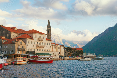 Fotobehang Groen blauw View of old town of Perast with bell tower of church of St. Nicholas. Bay of Kotor, Montenegro, autumn