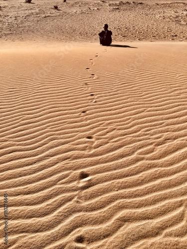 Deurstickers Canarische Eilanden man on the dunes of Corralejo,Fuerteventura,Canary islands, Spain