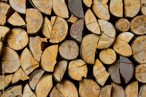 Deurstickers Brandhout textuur regularly laid pieces (logs) of wood for the fireplace