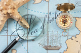 magnifier and compass on  map - 180282444