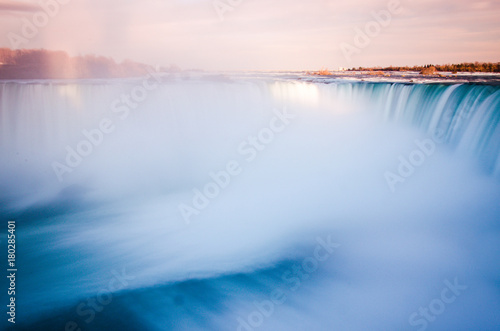 Long exposure of Niagara falls during the sunset Photo by knik