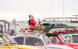 Santa Claus at the exhibition of retro cars Volkswagen, Agde, France. Copy space for text.
