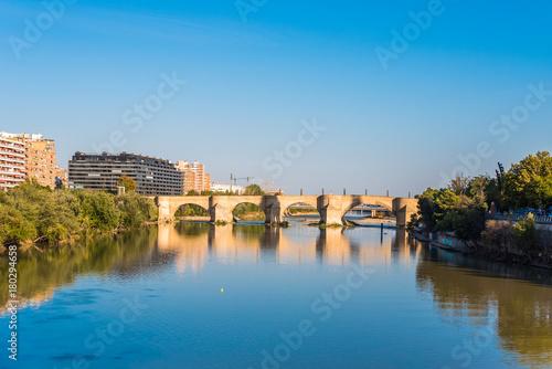 Bridge over the Ebro River, Zaragoza, Spain. Copy space for text.