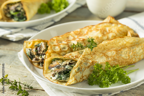 Savory Homemade Mushroom and Spinach Crepes - 180295848