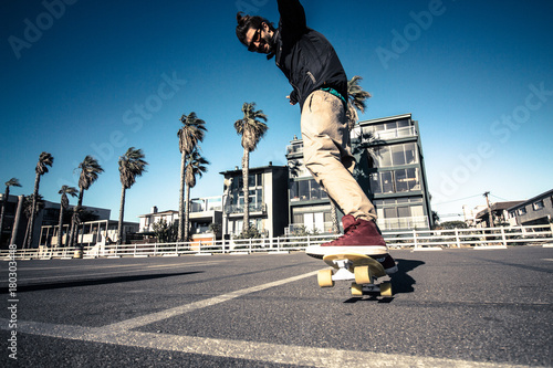 Aluminium Skateboard young man riding his skateboard