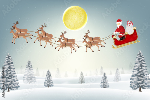 santa claus with reindeer on winter forest hill