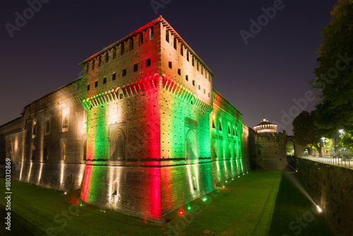 Keuken foto achterwand Milan Sforza's castle in a multicolored night illumination. Milan, Italy