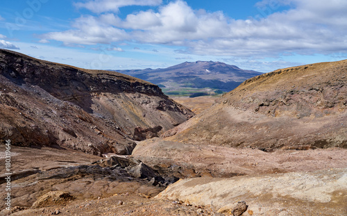 Foto op Plexiglas Blauwe hemel Walking route in the crater of the active volcano Mutnovsky on the Kamchatka Peninsula. Canyon at the entrance to the caldera of the volcano.