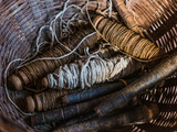 Rolls of lotus fiber thread in a basket at lotus cloth weaving factory, Inle lake, Shan State, Myanmar - 180321227
