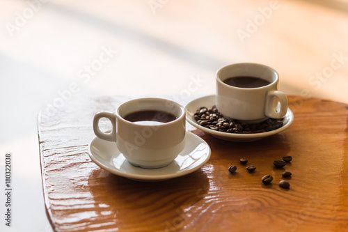 Papiers peints Cafe two white cups of black coffee on the table