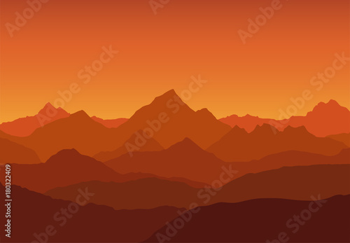 Foto op Plexiglas Bruin panoramic view of the mountain landscape with fog in the valley below with the alpenglow orange sky