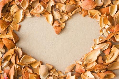 Aluminium Kersen nuts shells on natural background