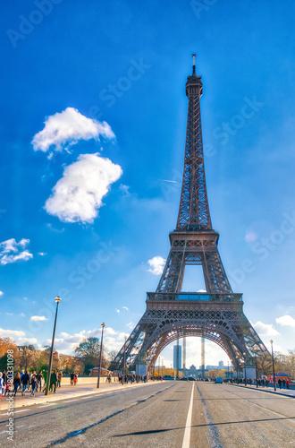 Plagát PARIS, FRANCE - DECEMBER 2012: Tourists visit Eiffel Tower
