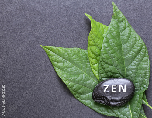 Plexiglas Zen Stenen stone with the inscription Zen - a symbol of peace and balance