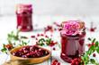 Red berry jam in a jar on table, natural organic product - homemade preserve for winter - 180335083