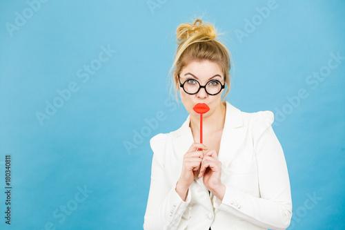 Plakat Happy woman holding fake lips on stick