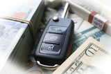 Car Key Surrounded By Stacks Of Money