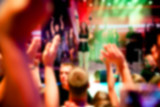 Blurred for background. Ibiza night club. Artist performs songs and dance show from stage during concert at nightclub. Artist on club stage during night party. - 180345489